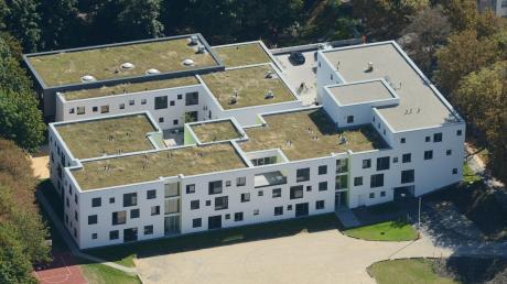 DasEllinor-Holland-Haus im Augsburger Textilviertel bietet Hilfesuchenden ein sicheres Zuhause auf Zeit.