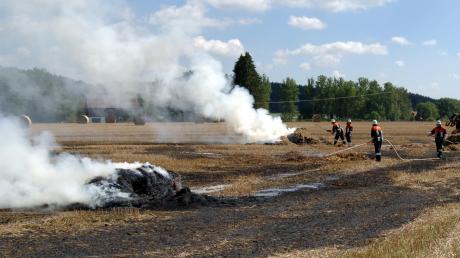 Strohballenpresse fängt an zu brennen
