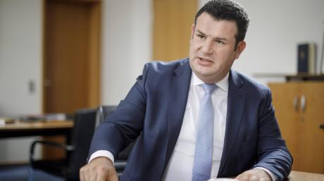 Hubertus Heil will in der Koalition bei der Umsetzung umstrittener Sozialprojekte Druck machen.