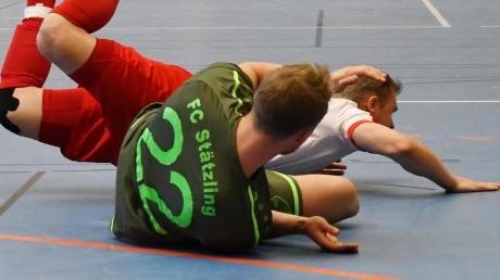 Ein Bild mit Symbolcharakter: Die Futsal-Spieler liegen am Boden. Ihre Sportart kämpft um Akzeptanz.