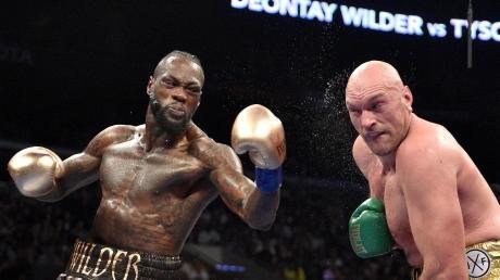 Deontay Wilder (links) gegen Tyson Fury: Am Samstagabend steht das zweite Duell der beiden an.