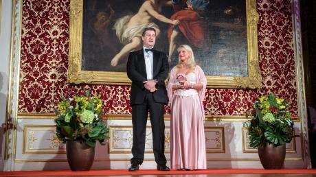 Er versucht vorzuleben, dass sich etwas ändern muss:Markus Södermit Ehefrau Karinbeim Neujahrsempfang derStaatsregierung in der Münchner Residenz.