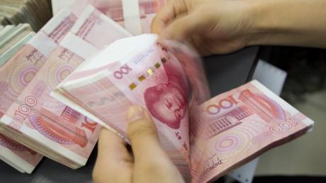China wertet seine Währung ab.