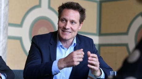 """Grünen-Fraktionschef Ludwig Hartmann sagt, die Gesellschaft zwinge CSU-Chef und Ministerpräsident Markus Söder beim Klimaschutz zum Handeln. Er sei ein """"Getriebener""""."""