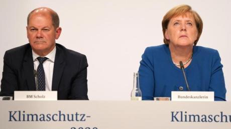 Kanzlerin Angela Merkel und Finanzminister Olaf Scholz bei der Pressekonferenz nach der Sitzung des Klimakabinetts.
