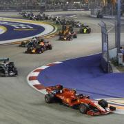 Sebastian Vettel hat beim Großen Preis von Singapur wieder einen Sieg eingefahren. Foto: Vincent Thian/AP