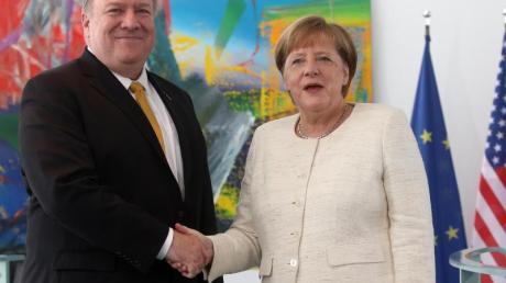 Angela Merkel (CDU), Bundeskanzlerin, empfing im Mai 2019 im Bundeskanzleramt Mike Pompeo, Außenminister der Vereinigten Staaten von Amerika. Foto: Wolfgang Kumm/dpa/Archiv