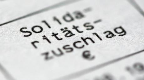 Der volle Solidaritätszuschlag soll nur noch von den reichsten 3,5 Prozent der Steuerzahler gezahlt werden. Foto: Roland Weihrauch/dpa