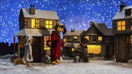 Scrooge erscheint der Geist der diesjährigen Weihnacht.