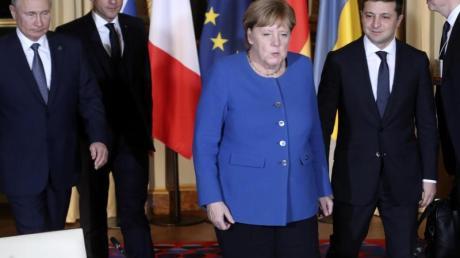 Wladimir Putin, Emmanuel Macron, Angela Merkel und Wolodymyr Selenskyj kommen zum Gespräch zusammen.