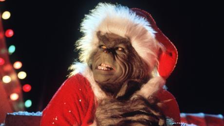 """Jim Carrey als Grinch in """"Der Grinch"""" wiederrum verkleidet als Weihnachtsmann, der einen fiesen Plan hat."""