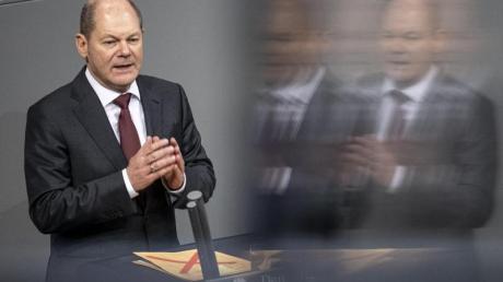 Bundesfinanzminister Olaf Scholz glaubt nicht, dass die geplant Kassenbon-Pflicht den deutschen Handel übermäßig belasten wird.