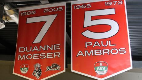 Die Rückennummern 5 und 7 werden bei den Augsburger Panthern nicht mehr vergeben. Sie hängen zu Ehren von Paul Ambros und Duanne Moeser unterm Dach des Curt-Frenzel-Stadions.