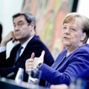 Die Umfragewerte der Union sind in der Corona-Krise nach oben gegangen. Die Menschen sind offenbar zufrieden mit der Arbeit von Kanzlerin Angela Merkel und Ministerpräsident Markus Söder.