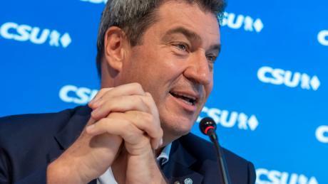 Der bayerische Ministerpräsident und CSU-Vorsitzende Markus Söder setzt in der Coronavirus-Krise auf Ratschläge von CDU-Kanzlerin Angela Merkel.