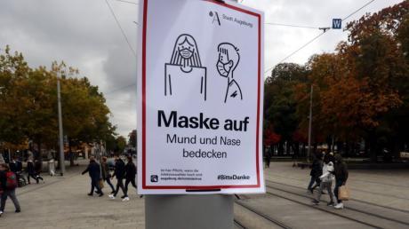 Beispielsweise in Augsburg muss in der Innenstadt Maske getragen werden.