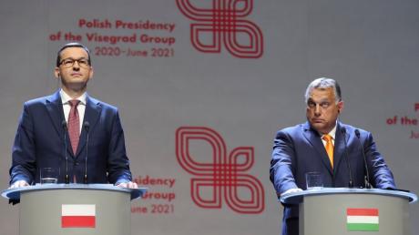Der polnische Ministerpräsident Mateusz  und sein ungarischer Amtskollege Viktor Orban fordern die Europäische Union heraus.
