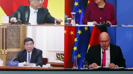 Verbunden per Videoschalte: Bundeskanzlerin Angela Merkel und Bundeswirtschaftsminister Peter Altmaier sprechen mit dem chinesischen Ministerpräsidenten Li Keqiang (oben links) und dem Vorsitzenden der Nationalen Entwicklungs- und Reformkommission Chinas (NDRC), He Lifeng.