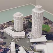 Das Modell zeigt die geplante Bebauung am Wittelsbacher Park: Rechts ist der Hotelturm mit der Kongresshalle zu sehen, links der geplanten Neubaukomplex.