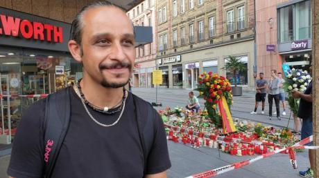 Mutig: Chia Rabiei vor dem Kaufhaus in der Innenstadt, in dem ein Mann Menschen mit einem Messer attackiert hatte.