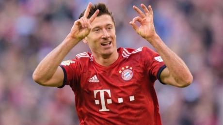 Hat die 200er-Marke der Bundesliga geknackt: Robert Lewandowski feiert das 2:0 gegen Dortmund. Foto:Matthias Balk/dpa