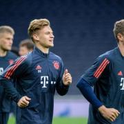 Noch gemeinsam beim FC Bayern: Joshua Kimmich (M) und Thomas Müller. Foto: Matthias Balk/dpa