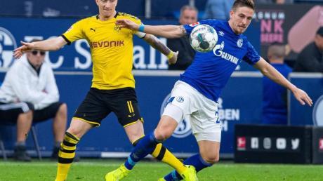 Marco Reus (l) hat noch nie auf Schalke getroffen - auch in seiner Gladbacher Zeit nicht.