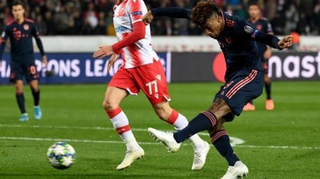 Kingsley Coman (r) will noch lange beim FC Bayern München bleiben.