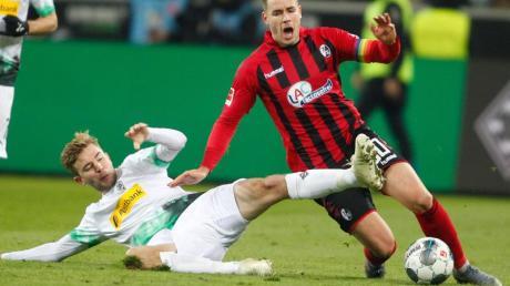 Christoph Kramer (l) bleibt Borussia Mönchengladbach erhalten.