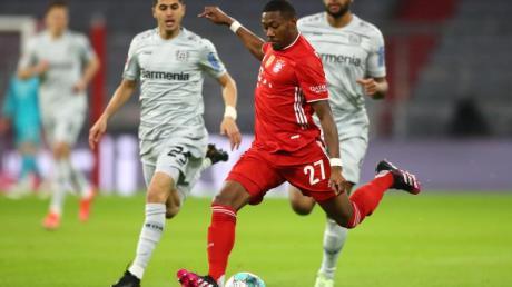 David Alaba (M.) wird den FC Bayern verlassen.