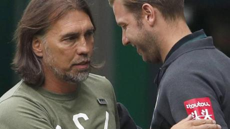 Martin Schmidt (links) und Florian Kohfeldt beim Spiel in Bremen.