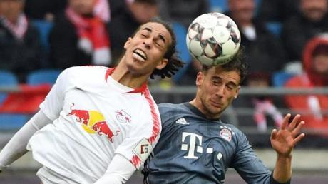 Leipzigs Yussuf Poulsen und Münchens Leon Goretzka werden am Sonntag wieder aufeinandertreffen.