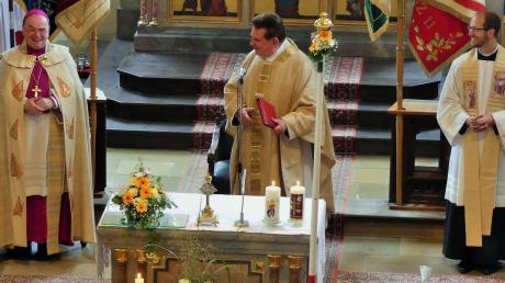 Verstehen sich: Beim Gottesdienst (von links): Bischof Bertram Meier, Monsignore Horst Grimm und Pfarrer Thomas Kleinle.