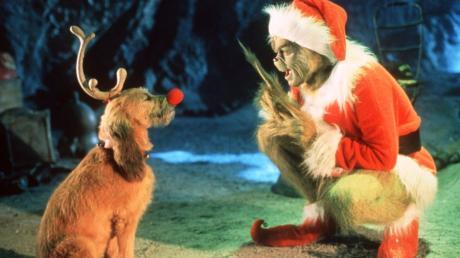 Jim Carrey als Grinch und wiederrum verkleidet als Weihnachtsmann, der einen fiesen Plan hat.