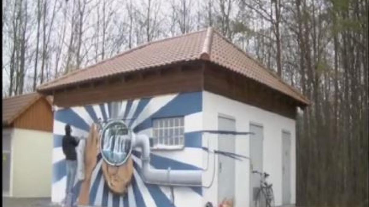 augsburg video graffiti k nstler versch nert stadtwerke. Black Bedroom Furniture Sets. Home Design Ideas