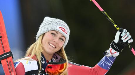 P_1283S7 US Mikaela Shiffrin celebrates after finishing third during the FIS World Cup Womens Giant Slalom competition in Ofterschwang, southern Germany, on March 9, 2018. / AFP PHOTO / Christof STACHE