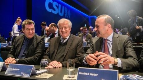 Wollen jetzt zusammenhalten: Markus Söder, Horst Seehofer und Manfred Weber.