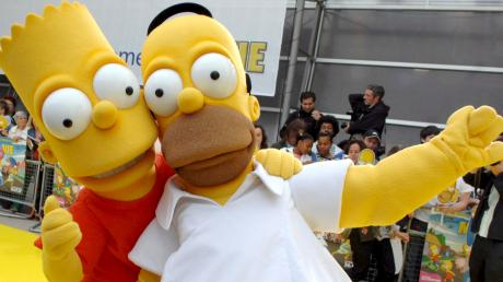 """Verkleidete Schauspieler bei der Premiere des Films """"Die Simpsons"""". Er spielte mehr als eine halbe Milliarde Dollar ein. Die Serie gibt es seit 30 Jahren. (Archivfoto)"""