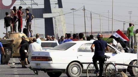 Die Sicherheitslage im Irak ist aufgrund von Massenprotesten gegen Korruption und Misswirtschaft seit Wochen höchst angespannt. Foto: Nabil Al-Jurani/AP/dpa