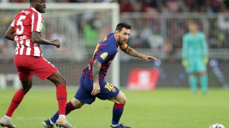 Lionel Messi (r) musste sich mit dem FC Barcelona geschlagen geben.