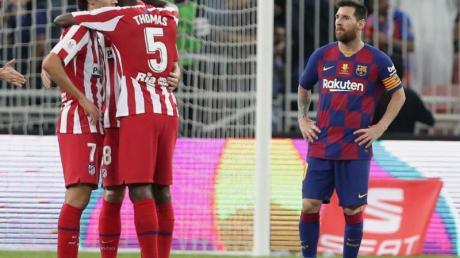 Bedient: Lionel Messi (r) nach der Barca-Pleite gegen Atlético.