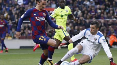 Antoine Griezmann (l) hatte großen Anteil am Barca-Sieg gegen Getafe.