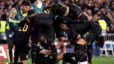 Die ManCity-Profis feiern den Auswärtssieg bei Real Madrid.