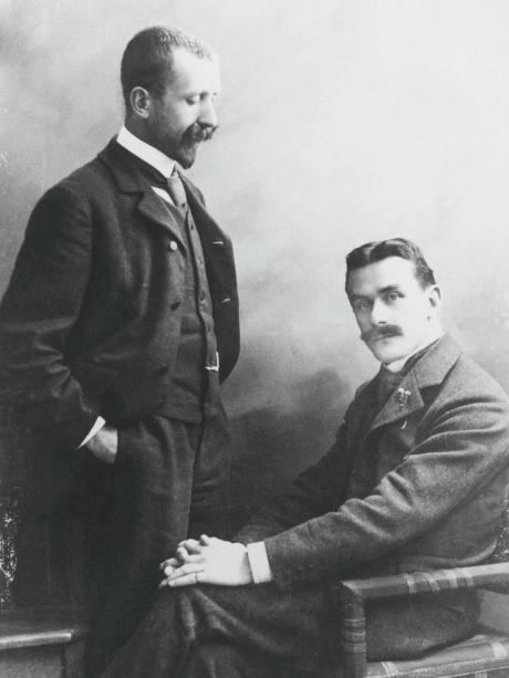 Two great literary figures: Heinrich Mann (standing) and his brother Thomas Mann in 1905.