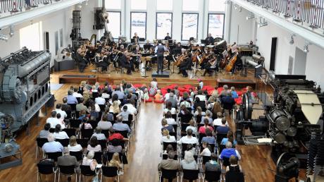 Musik zwischen Maschinen: Das Sponsoring mit MAN Energy Solutions brachte auch verschiedenste Auftritte der Philharmoniker im MAN-Museum mit sich, hier ein Familienkonzert.