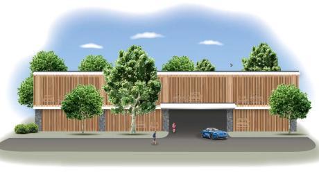 Der Landkreis will drei Gebäude mit Mikrowohnungen und ein Parkdeck bauen. Die Skizzen zeigen, wie diese Bauten aussehen könnten, die Planungen sind jedoch noch am Anfang. Landrat Thomas Eichinger und Klinikumvorstand Marco Woedl stellten sie auf einem Pressetermin vor.