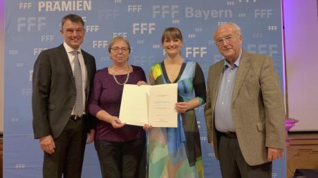 Auszeichnung fürs Olympia Filmtheater Landsberg: (von links) Oberbürgermeister Mathias Neuner, Klara Gilk, Judith Gerlach undRudolf Gilk.