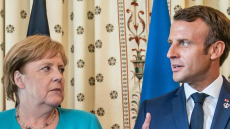 In Paris treffen sich Angela Merkel und Frankreichs Präsident Macron heute mit Putin und Selenskyj zu einem Friedensgipfel für die Ostukraine.