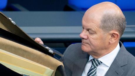 Mappe auf, Kasse leer? Finanzminister Olaf Scholz will eine gemeinsame europäische Steuer auf Aktiengeschäfte einführen. Eine Mehrheit dafür ist allerdings noch nicht in Sicht.