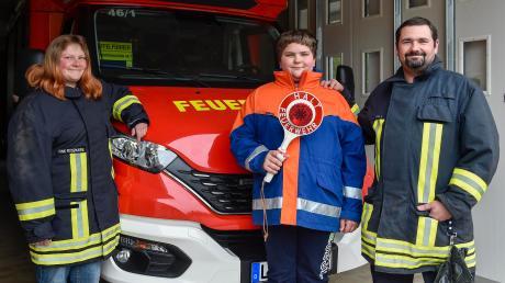 """Rosemarie, Florian und Ludwig Fink haben das """"Feuerwehr-Gen"""": Die Familie engagiert sich seit Jahren bei der Wehr in Obermühlhausen."""